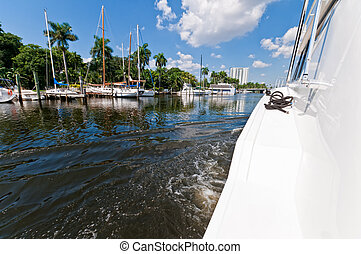 Yacht in the river - Yacht navigating the Miami river with...