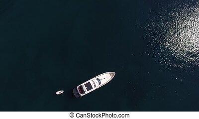 Yacht in the sea, aerial photography drone, Budva, near Dukley Gardens