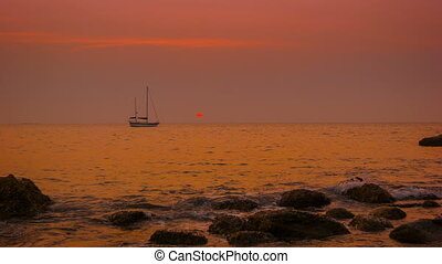Yacht in the tropical bay. Sunset on the ocean
