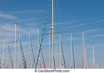 yacht mast on a blue sky background