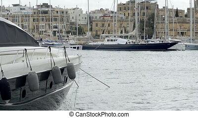 Yacht moored at Manoel Island Marina in Malta. View of  sail boats in a row on docks at seaside harbor.