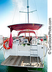 Yacht on an anchor in harbor. - Yacht in harbor. Back view ...