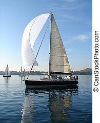 Yacht on calm sea - Yacht sailing on calm sea with blue sky...
