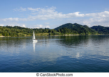 yacht on calm waters of the Czorsztyn Lake in Poland