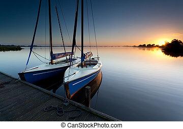 yacht on lake harbor at sunrise