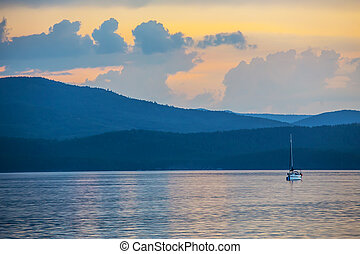 yacht on the lake in the evening