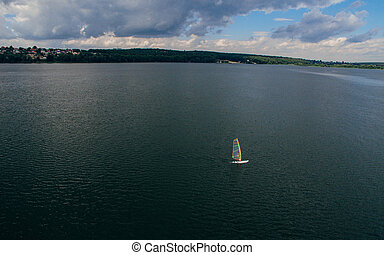 Yacht on the lake in the evening before a thunderstorm. Aerial view