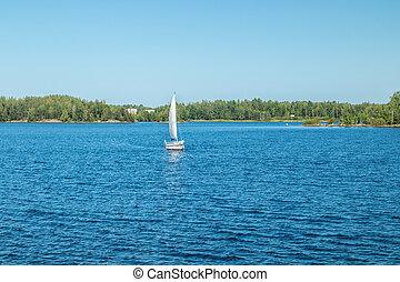 Yacht on the lake Saimaa on a sunny summer day, Lappeenranta, Finland