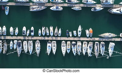 Yacht parking, A marina lot, yachts and sailboats are moored...