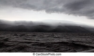 Yacht rails on background of dark gray clouds in sky and...