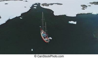 Yacht sail in arctic iceberg coast aerial view - Yacht Sail...
