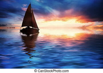 Yacht sailing against sunset