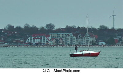 Yacht sailing and windmill