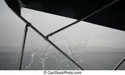 Yacht sailing in the rain on background of sea in Greece....