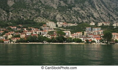 Yacht sailing on the sea with amazing landscapes of Montenegro, Budva on background