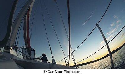 Yacht sailing on the wind on sunset. Beautiful newlywed...