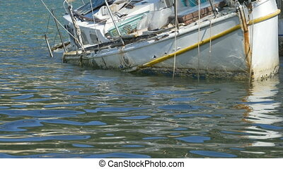 Yacht Wreck Floating - Yacht wreck on shallow waters.