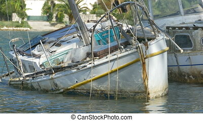 Yacht Wreck on Harbor - A yacht wreck in the port on shallow...