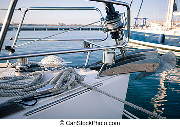 Yachting, sailing winch and ropes the front of the boat