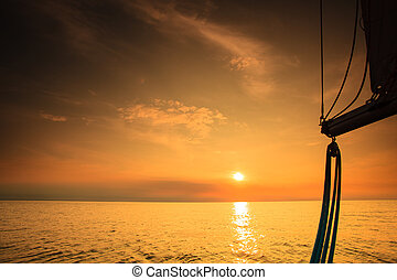 Yachting yacht sailboat in baltic sea at sunset sunrise. - ...