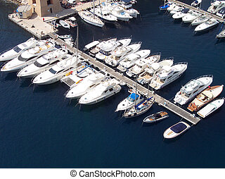 A collection of luxury yachts in Monaco Harbour