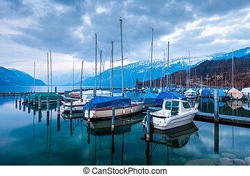 Yachts and boats on Lake Thun in the Bernese Oberland,...