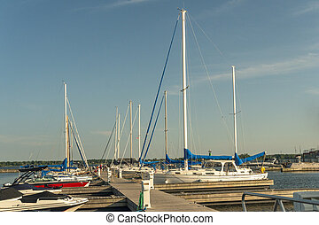 Yachts and boats on the pier in the river bay