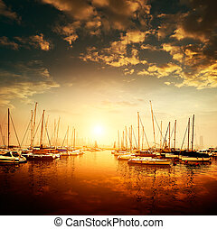Yachts and marina - Yachts and pier at dusk