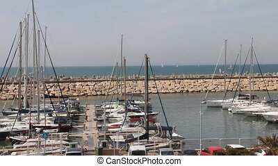 Private boat begins mooring in the marina