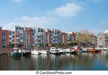 yachts in canal - several yachts moored in a newer part of...
