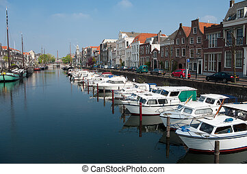 yachts in canal - several yachts moored in the monumental...