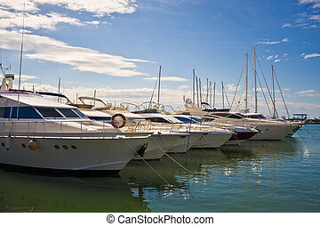 A line of yachts moored in marina Cambrils Spain
