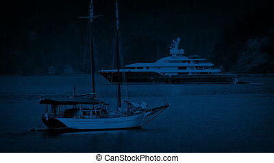 Yachts In The Bay At Night - A traditional wooden yacht...
