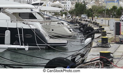 Yachts moored at Manoel Island Marina in Malta. Sail boats in a row on docks at seaside harbor.