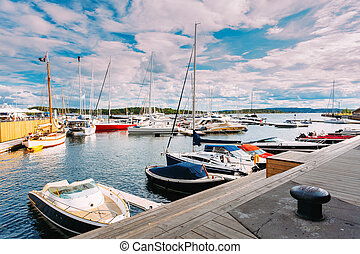 Yachts moored at town quay in district Aker Brygge, Oslo, Norway