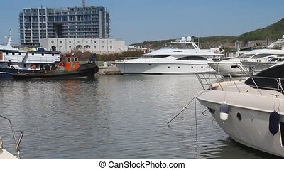 Luxury private yachts moored in the marina