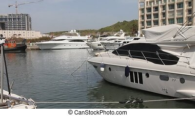 Yachts moored in the marina - Luxury private yachts moored...
