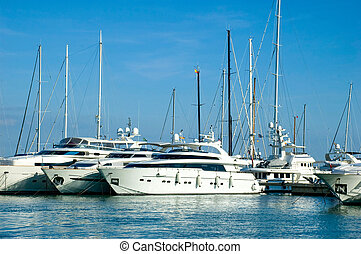 Yachts Moored in the Marina - Yachts docked at the marina in...