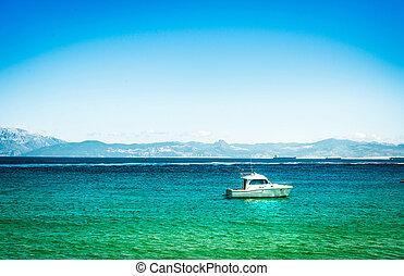 Yacht on azure sea water in Tarifa, Spain