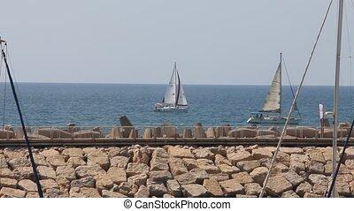 Yachts - Boats float past the marina