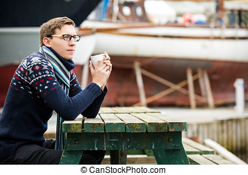 Yachtsman with coffee