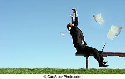Yahoo! - Business man is celebrating on the park bench, ...