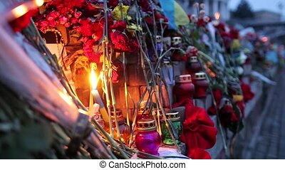 Yahrzeit candles and flowers at the Independence Square in...