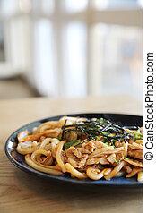 Yakisoba pork on wood , Japanese food