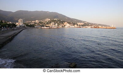 YALTA - February 4. Panorama view of Yalta town from the Black sea. Winter sunset. Crimea.