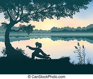 Yang woman performs Snake Creeps Down Form of Tai Chi near the lake