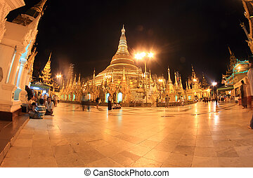 YANGON, MYANMAR - NOVEMBER 18: Buddhist devotees pray at the...