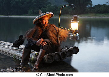 YANGSHUO - JUNE 18: Chinese man fishing with cormorants ...