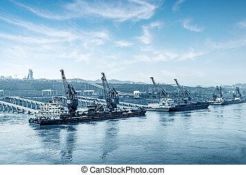 Yangtze River pier - China Yangtze River docks and cranes.
