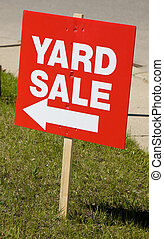 Yard sale sign on lawn